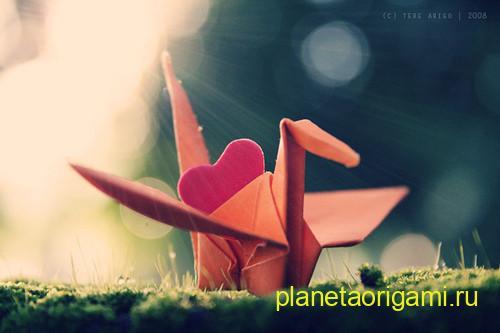 Оригами динозавр оранжевого цвета