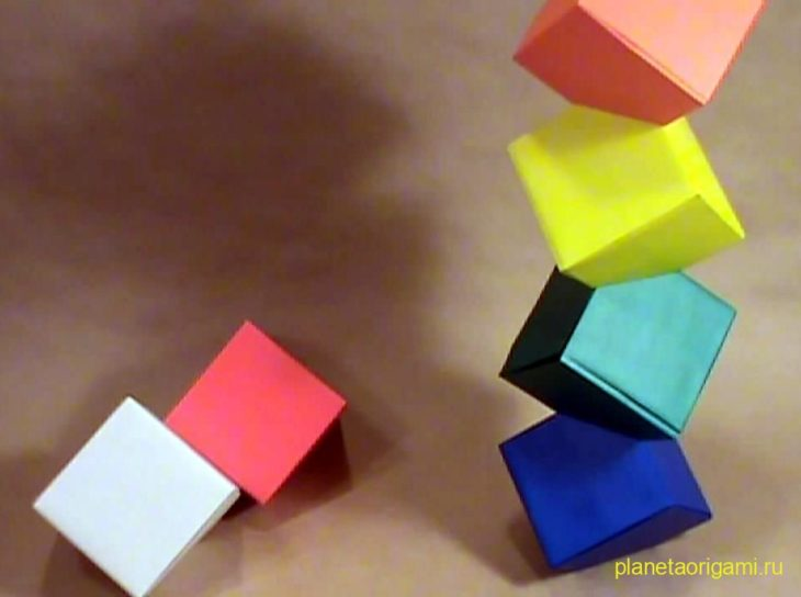 Origami tutorial: Cube tower by llifi-kei on deviantART.