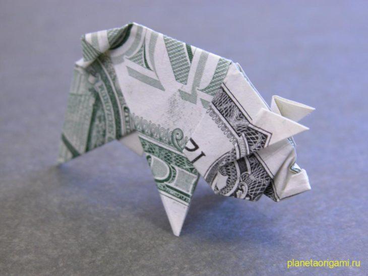 Оригами-украшения из денег от мастера Tine De Ruysser