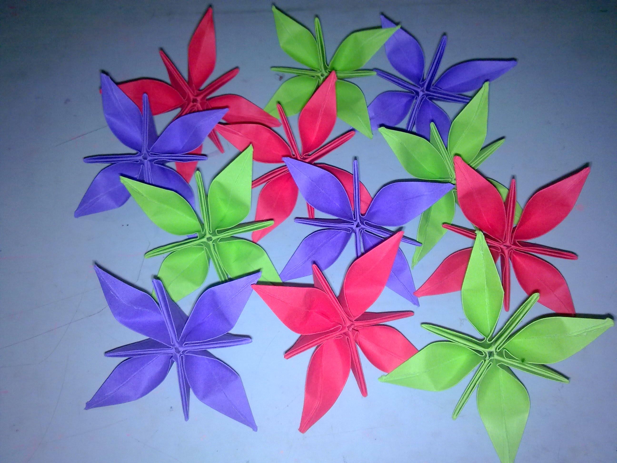 Оригами цветок с четырьмя лепестками